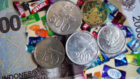 Permen pengganti uang kembalian (foto ist)