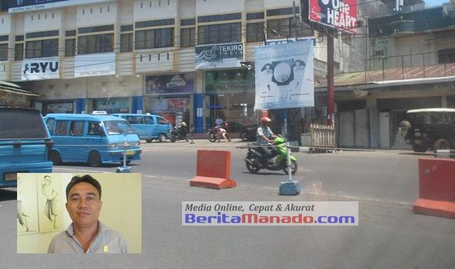 Marka jalan di depan SPBU Paldua (insert: Winston Monangin)