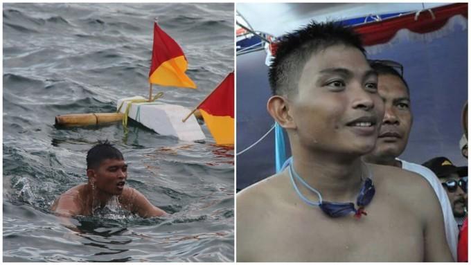 Laksono Putro ketika tiba di finish setelah berenang menyebrangi Selat Lembeh