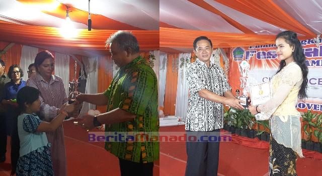 Bupati Vonnie Panambunan dan Ketua DPRD Minut Berty Kapojos membagikan hadiah kepada pemenang lomba.