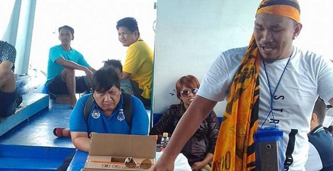 Mongol bersama wartawan di kapal menuju pulau Bunaken