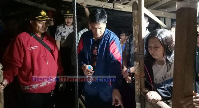 Kapolres Minut AKBP Eko Irianto SIK memantau lokasi longsor, didampingi Hukum Tua Tatelu John Lausan.