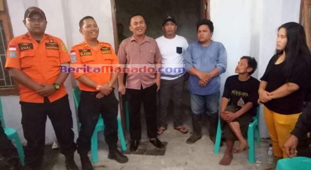 Tim Basarnas Manado bersama Hukum Tua dan keluarga korban.