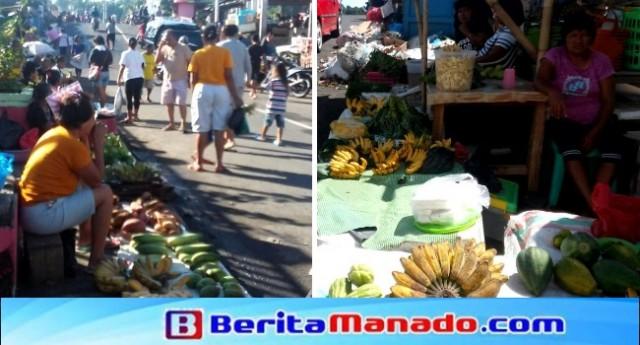 Para pedagang sayur dan umbi-umbian yang terpaksa berjualan di bawah terik matahari karena belum memiliki tempat berjualan tetap.
