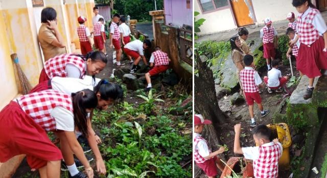 Siswa antusias membersihkan sekolah.